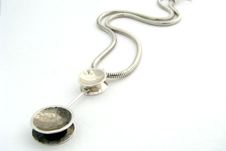 Tanya Krackowizer - new discus collection in silver and oxidised silver