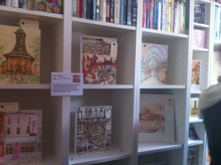 Clare's canvases nestled into her bookshelf