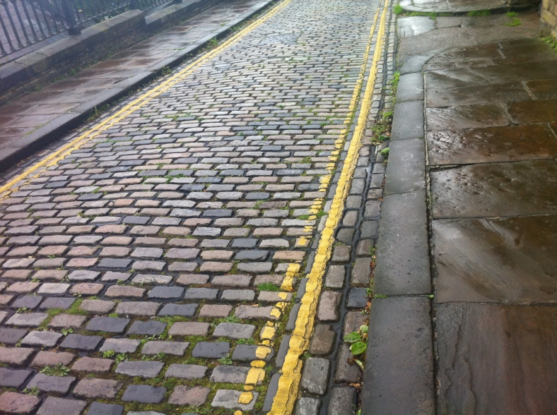 Wet cobbles in Saltaire
