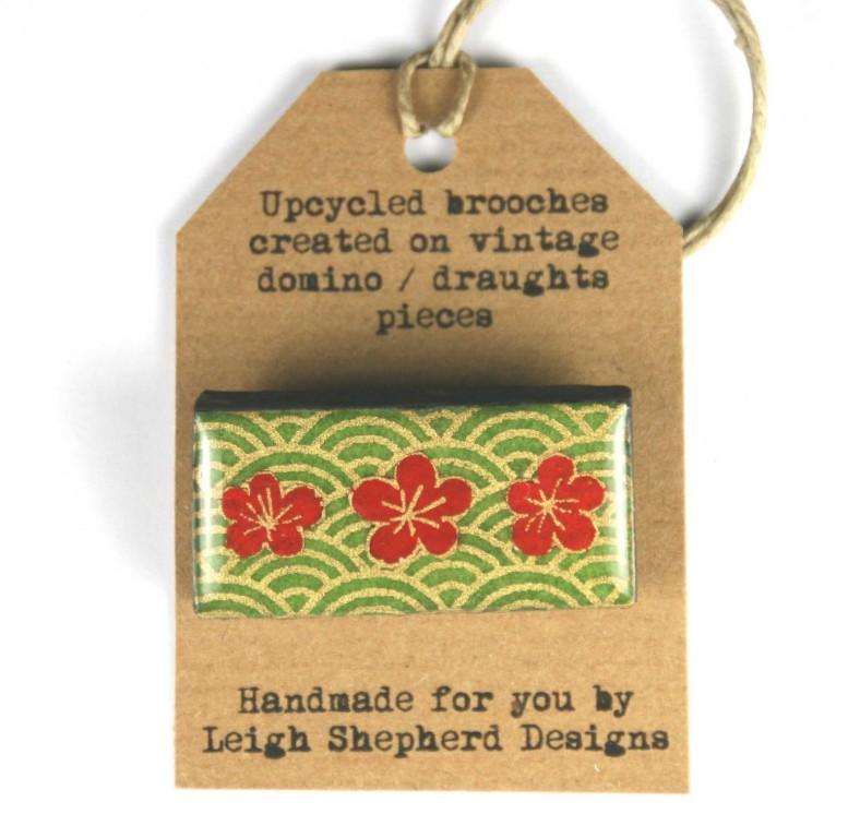 Domino brooch on display card