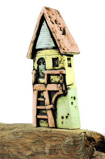Mark Smith - close up of ceramic house on driftwood
