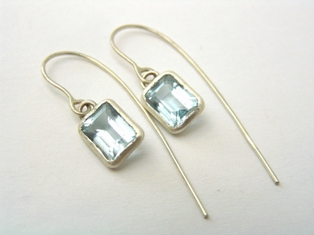 Silver earrings set with blue topaz