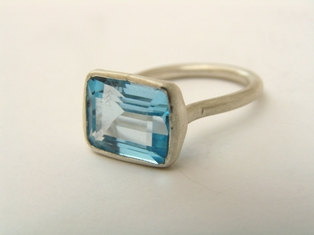 Silver rectangular ring set with blue topaz