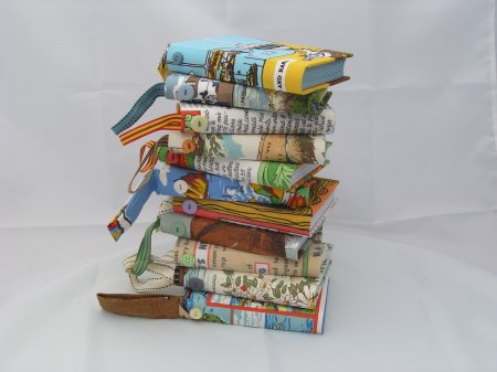 Pile of journals bound in tea towels - these can be personalised by Heather