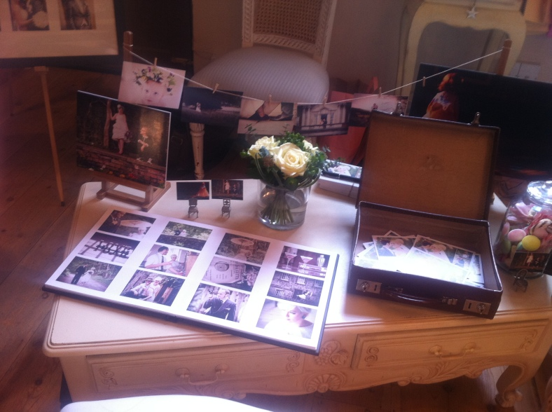 Sarah's display of her previous weddings and her new leather album
