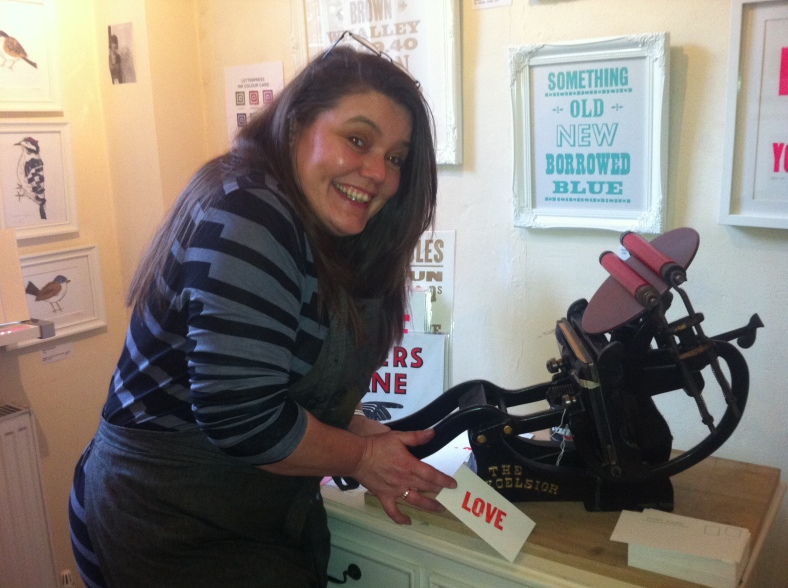 Jacqui Sharples with her small Victorian press at Heart Gallery