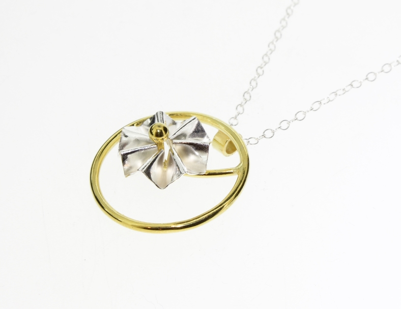 silver and gold rosette necklace