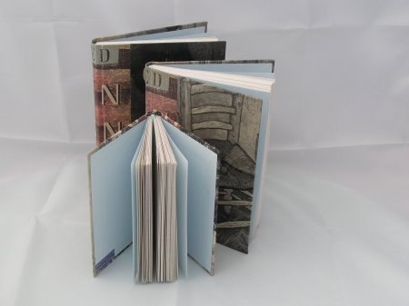 A set of Heather's journals, bound in the cover and pages of a 're-purposed' old book