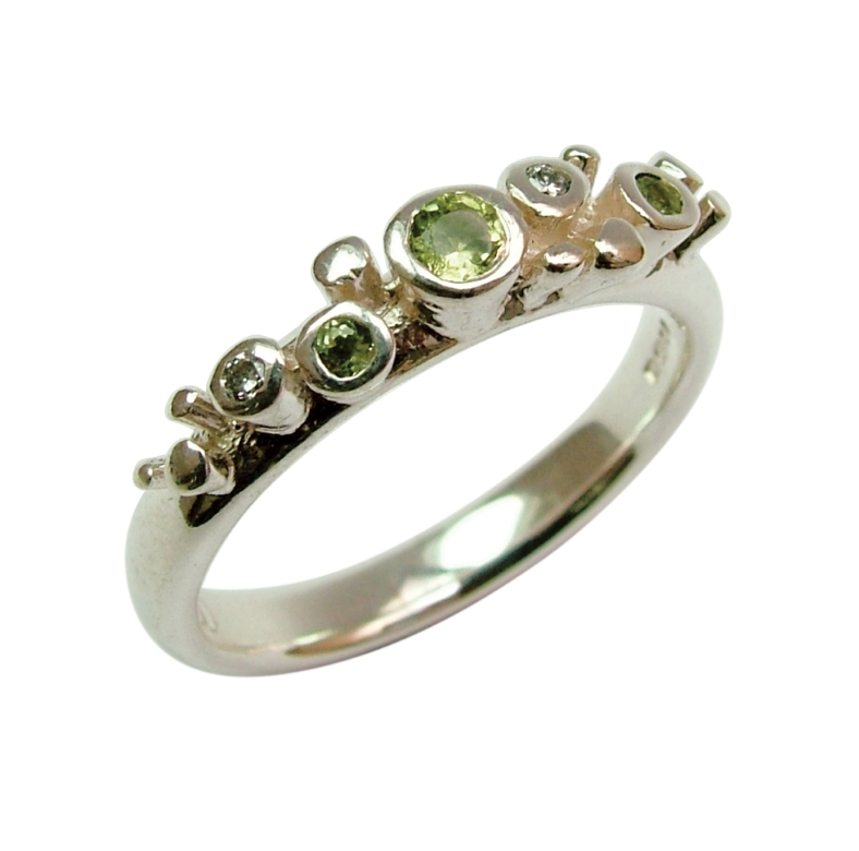 Meteor ring set with peridot and diamonds