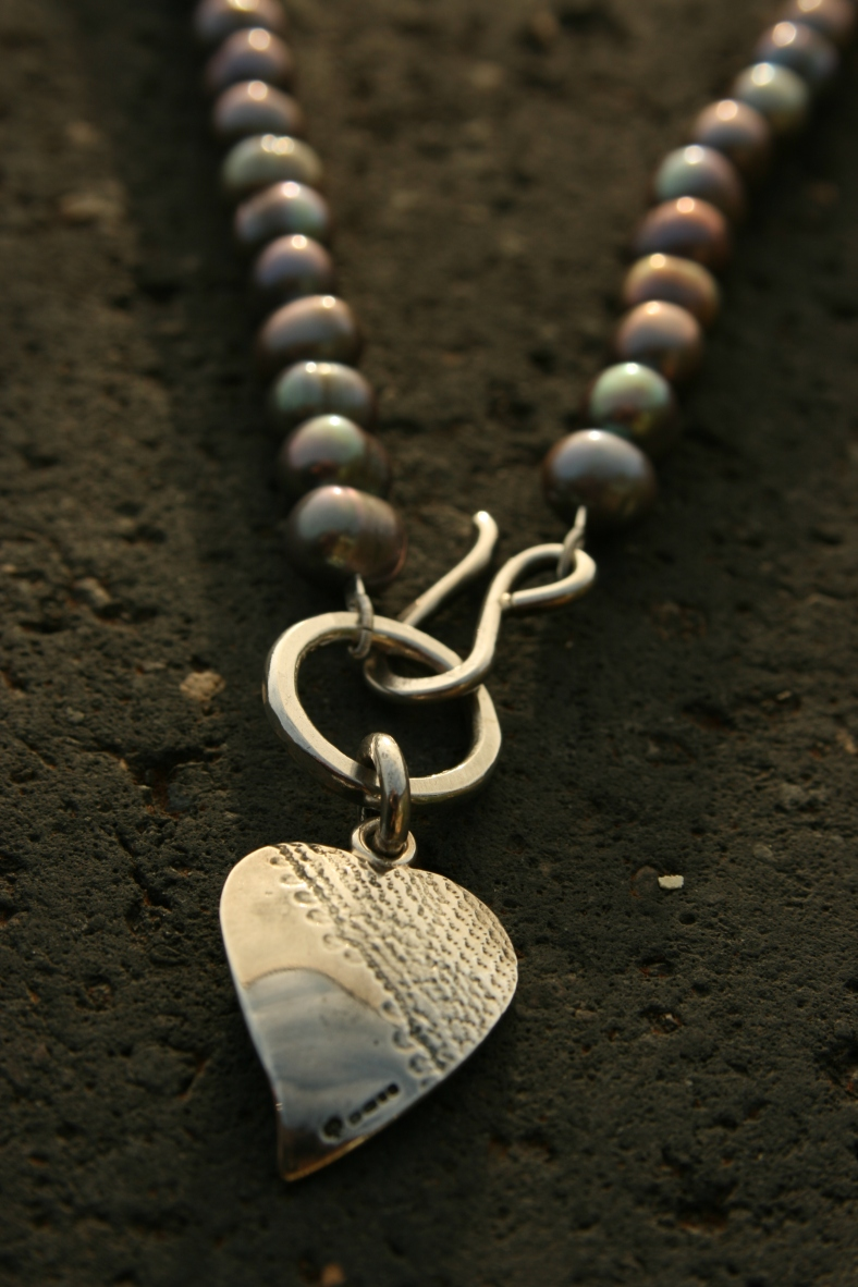 Silver textured heart necklace on fresh water pearls