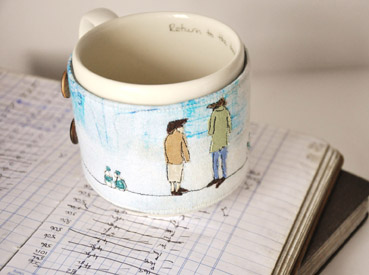 Milkround books with ceramic cup and textile cup cosy