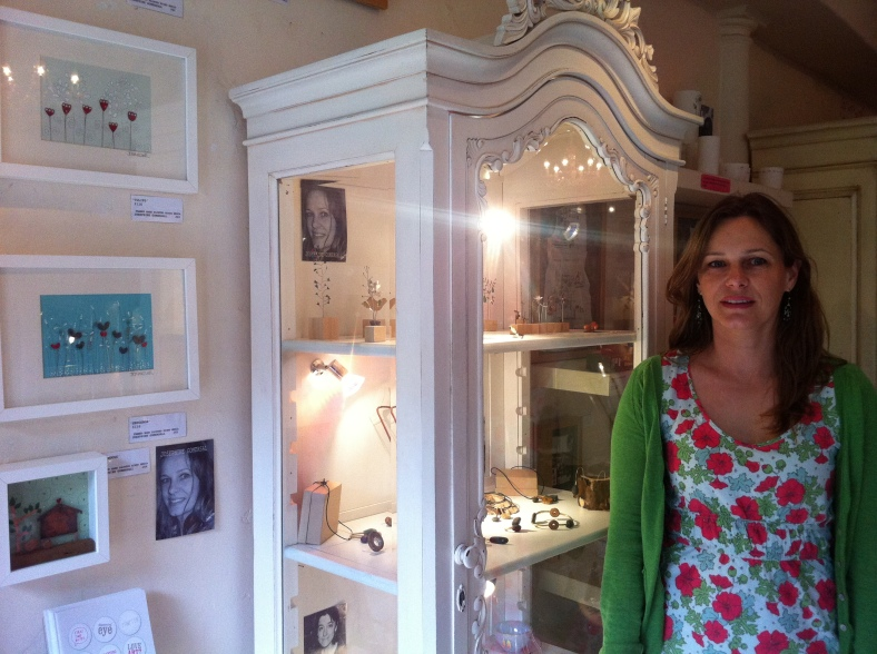 Josephine Gomersall with her collection of wall pieces and mini sculptures