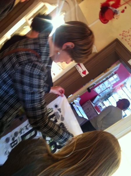 Customers enjoying the day - Andy Pointon's tea towel of Hebden Bridge always popular