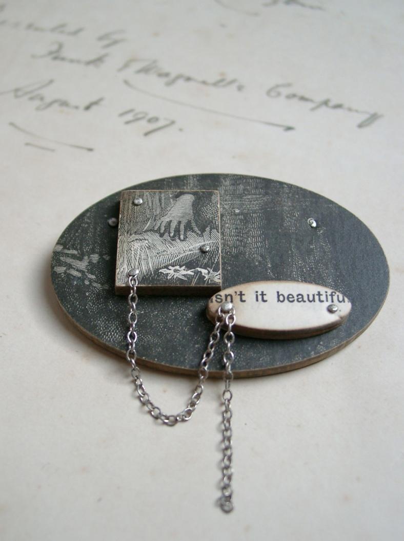'Isn't it beautiful' brooch
