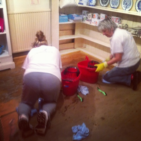 Cleaners in the back retail room that sells kitchen and homeware