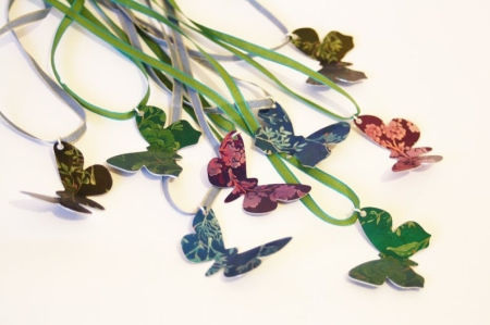 Butterfly pendants on ribbon
