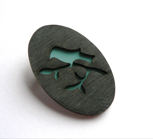 Oval birdie brooch