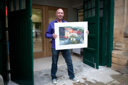 Jason Elliott, our Auctioneer, with a ltd edition print from Kate Lycett
