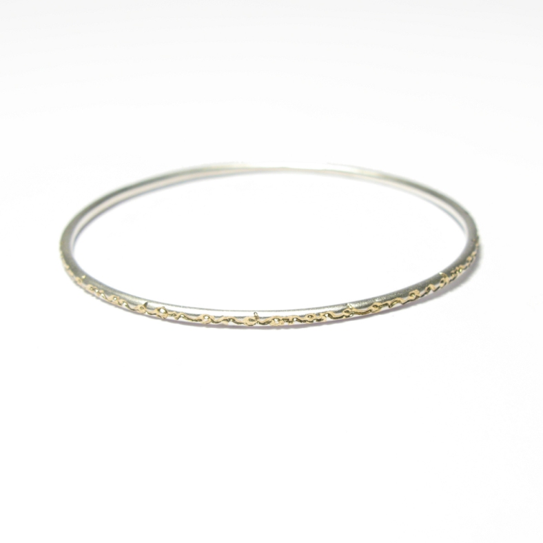 And on silver bangle etched with 22ct gold