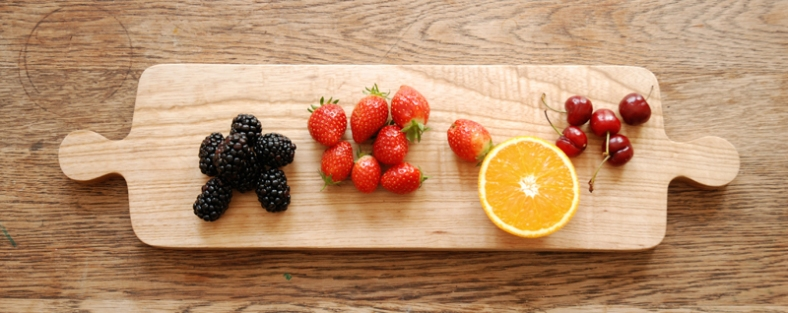 Wooden board with fruit