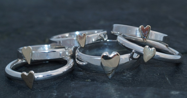 Silver and 9ct gold rings