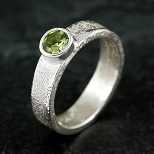 Silver melted ring with peridot