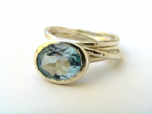 Gem ring stacked with a dappled ring