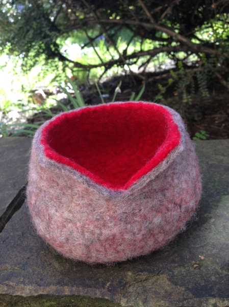 Felted bowl with red inner