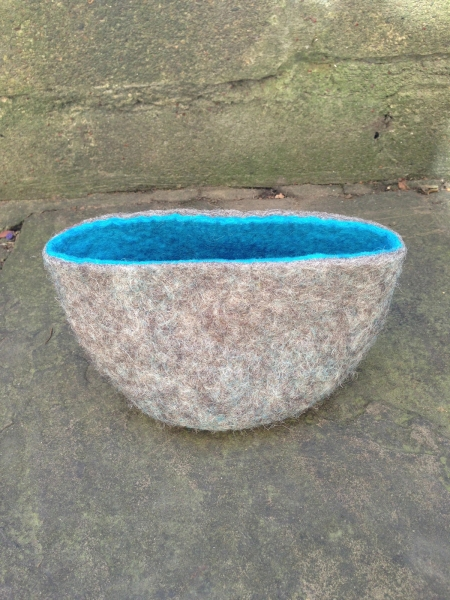 Felted bowl with blue inner