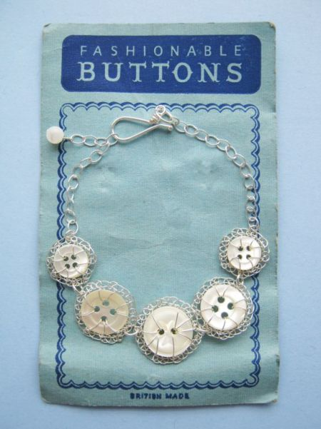 Silver five button bracelet