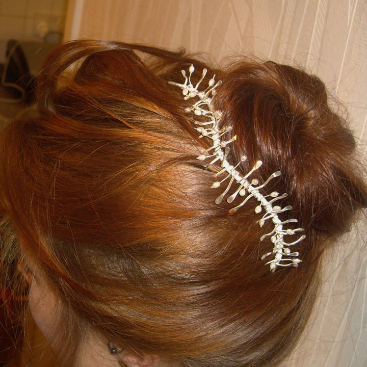 Silver hairpiece worn