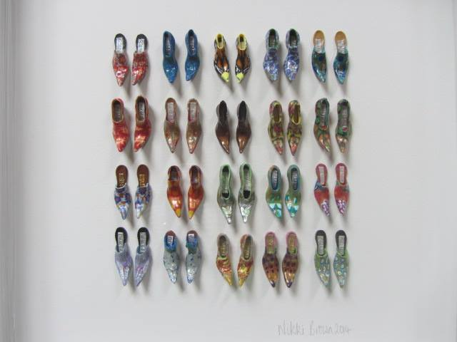 Framed selection of small shoes by Nikki Brown