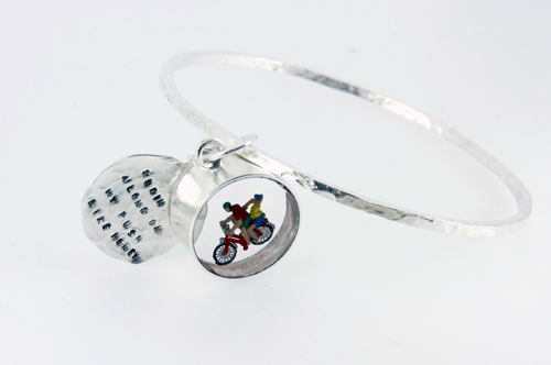 Charm angle with cyclist and text