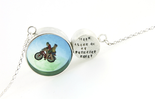 Necklace, round charm and barrel bead with cyclist and lyric's from a Mungo Jerry song