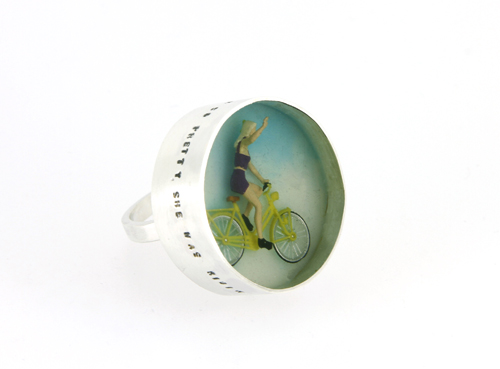 Stunning large ring with cyclist and text