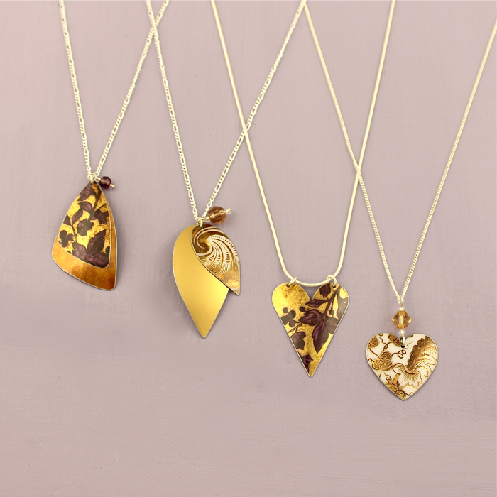 Purple and Gold necklaces from our current Christmas collection