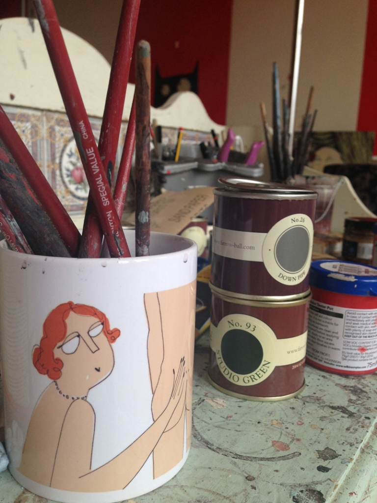 Close up of Angela's paints and brushes - why am I not surprised by the water vessel!