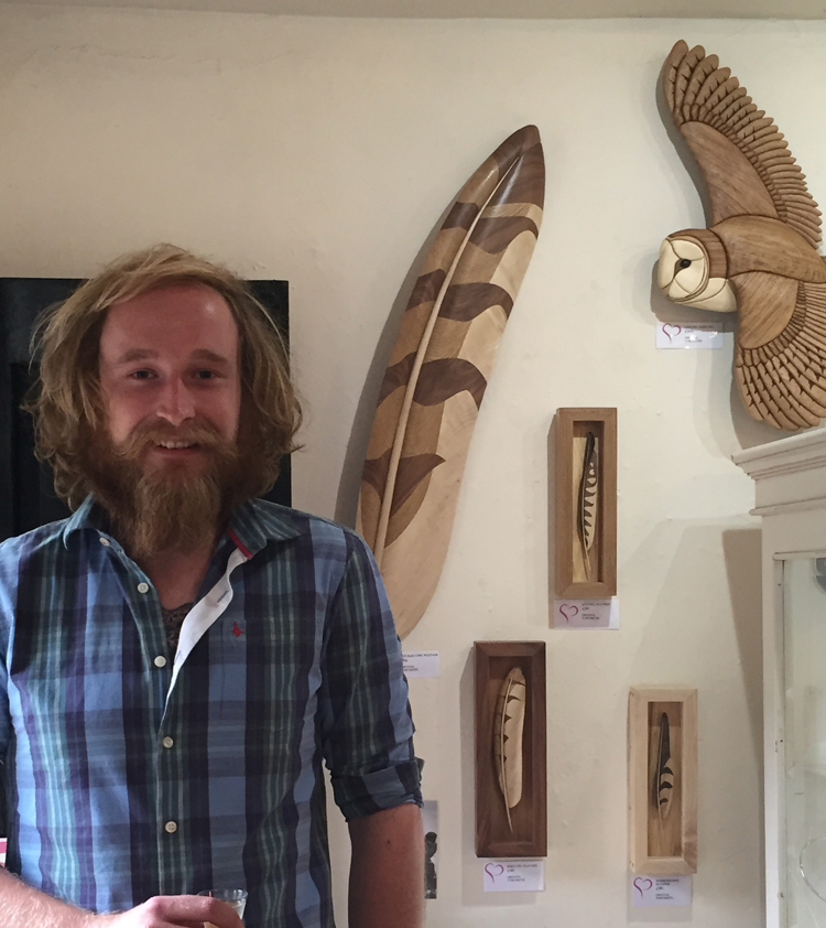 Tom Smith with a selection of his amazing realistic wood pieces made using a technique known as intarsia