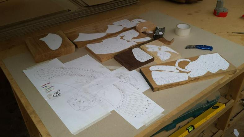 Tom first works on his designs then lays them out on the wood