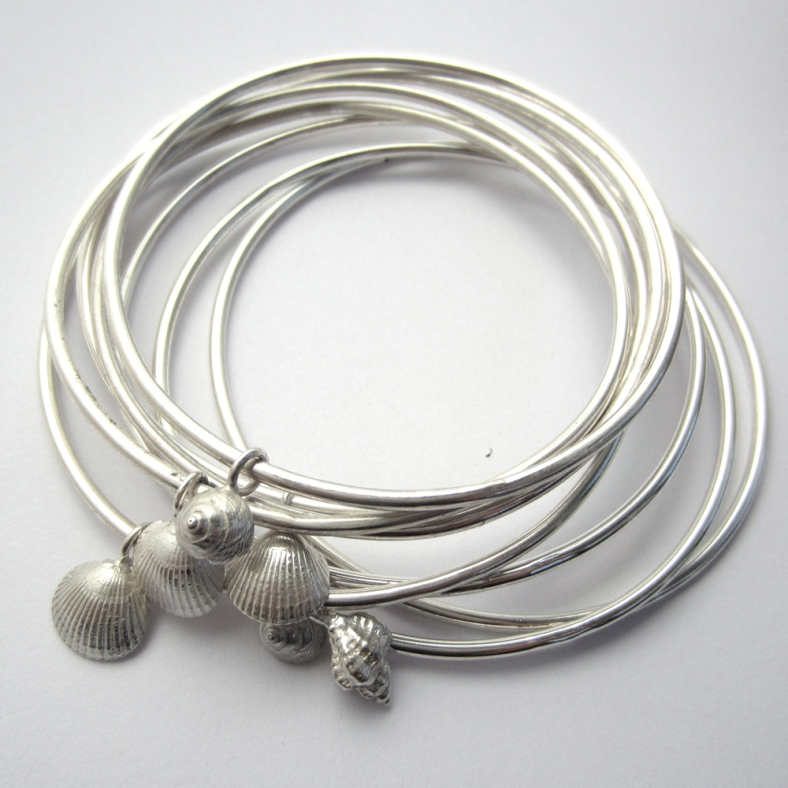Selection of silver shell bangles